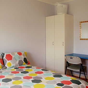 Bedroom, study desk, wardrobe at The Martyn share apartments close to hospital and city centre