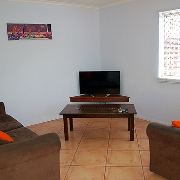 Lounge room with TV at Cairns Sharehouse The Lumley House