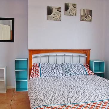 Student accommodation in Cairns at Cairns Sharehouse - bedroom at The Lumley with double bed and storage